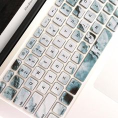 Protect your Macbook keyboard from dust, spills and key wear with the flexible marbled Marble Cover. Please note that print will vary. Keys are individually molded and keywords are printed on the cove