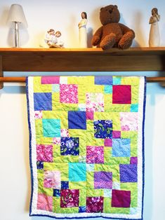Handmade baby quilts are one of the best gifts you can give as a baby shower gift. Sew Happy Quilting has unique quilts for baby girls and baby boys. Baby quilts are washable and are wonderful heirloom gifts that can be passed from generation to generation. Check out sewhappyquilting.com today. #babyquilt #babygirlquilt #babyshowergift #uniquebabygift #heirloomgift #babyblanket #nurserydecor #cribquilt Baby Girl Quilts, Baby Girl Blankets, Quilt Baby, Green Quilt, Green Fabric, Homemade Quilts For Sale, Handmade Baby Quilts, Modern Quilt Patterns, Quilted Wall Hangings