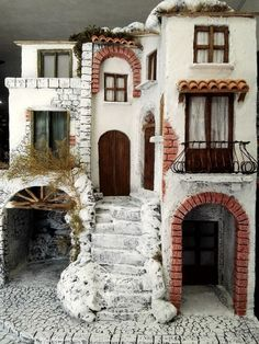 Greek style dollhouse. Love the details on the stucco and the stone steps