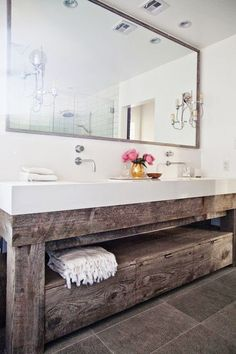 Adore this! The wood, the large mirror. Very beautiful for a bathroom!