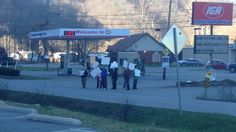 Protesters gather in support of former IGA employee