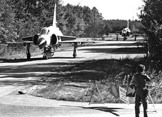 "Two Royal Swedish Air force SAAB AH37 Viggen (""Lightning bolt"") on a road, somewhere in Sweden 1973. © Försvarsmakten"