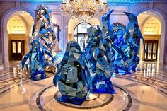 Mirrored penguins and polar bears in the lobby of the Four Seasons Paris. Designed and created by artistic director Jeff Leatham.