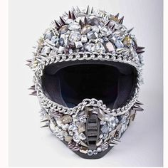 Highway To Hellmet by Deryck Todd/Harley Davidson/ This helmet is a must-have/ Rule the streets in this fully functioning motorcycle helmet. It's encrusted with giant Swarovski crystals and features hand-placed metal chains and spikes. Motorcycle Helmet Design, Full Face Motorcycle Helmets, Motorcycle Gear, Bike Helmets, Women Motorcycle, Vespa Helmet, Motorcycle License, Motorcycle Accessories, Biker Chick