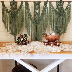 This stunning Macrame wall hanging will be sure to wow your guests! This handmade piece is made from 3mm 3 strand twist 100% cotton cord which has been hand dyed by me in what I like to call bottle green. Anchored from copper rod, measuring 103cm in length. The macrame design