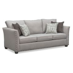 Built to Last. Make a grand statement with the Mckenna Queen innerspring sleeper sofa that exudes classic appeal. With its comfortable seating, this furniture features oversized nailhead trim adorning the ever-stylish flared arms. Complemented beautifully by patterned and contrast-colored accent pillows, the relaxing gray fabric is versatile and will match any décor.