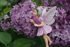 Lilac fairie: White May is flowering, Red May beside; Laburnum is showering Gold far and wide; But I sing of Lilac, The dearly-loved Lilac, Lilac, in Maytime A joy and a pride!  I love her so much That I never can tell If she's sweeter to look at, Or sweeter to smell.   Poem (and painting this figurine is based off)  by Cicely Mark Barker (1895-1973)