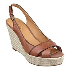 Crisscrossed toe straps top our breezy Clambake slingback wedge sandals wrapped with braided espadrille trim for a look that's ready for fun in the sun. Adjustable buckle closure. Padded footbed for all-day comfort. Leather or denim upper; mouse over color for upper information. Man-made lining and sole. Imported. 1 1/2 inch platforms. 3 3/4 inch wedge heels. Women's shoes. Slingback wedge sandals.
