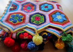 african flower with poms-To finish the hexagon quilt