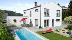 Fingerhut Einfamilienhaus weiß verputzt bodentiefe Fenster überdachter Eingangsbereich Swimmingpool Terrasse rote Liege roter Sonnenschirm