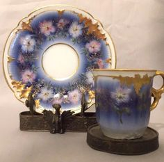 """Hand painted with heavy gold gilt, light blue to dark blue on white with light blue and pink flowers. Saucer Measures 4 3/4"""" in Diameter"""