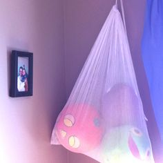 Got tired of Caden's sports equipment taking up all the room in his toy boxes. An old mess laundry bag hung with a hook on the wall. We'll see it it helps!