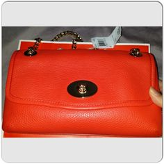 "Was $230 Coach leather clutch/crossbody Vibrant coral red with golden hardware, chain can be worn double as shoulder bag or single as crossbody, turn lock closure. Zipper back pocket,  inside has zipper pocket and 2 slip pocket. Leather is soft and thick. Brand new. 9.5""x5.5""x3"" 12"" drop double length,  24"" drop as single length. Chain is 48"" in length. Can be worn as clutch, top handle, shoulder or crossbody style. Can't beat this! PERFECT MOTHER's DAY GiFt!!! Price tag intact, comes with…"