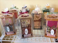 Handmade tea dispensers that I made for an upcoming craft fair. They are made with a variety of Stampin' Up! Papers and stamps.