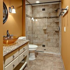 Modern Bathroom Vanity Design with Granite Cuntertop also Glass Bowl Under the Round Framed Wall Mirror Beautiful Small Bathrooms