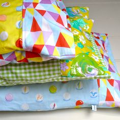 Pillowcase tutorial—This pattern has a double thickness cuff, which you can sew in a contrasting print and an internal flap to keep the pillow inside hidden.