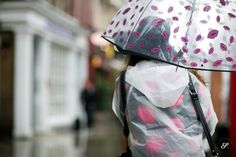 Amber Haly fighting the rain during London Fashion Week with an umbrella from Zara. Street style photo of a women beating the rain in fashio...