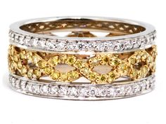 This is the last one! An 18k white and yellow gold ring features .46 carats of yellow diamonds & .44 carats of white diamonds!