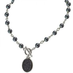 Paired with black ringed freshwater pearls, this Honora pearl and druzy necklace will get you noticed and take center stage!