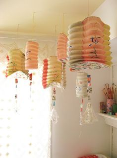 "faded japanese lanterns with fabric scrap ""kite tails"""