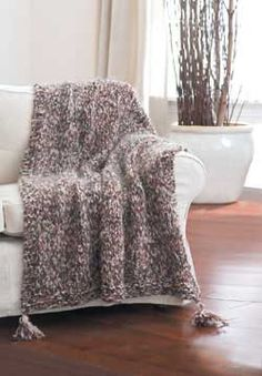 A fast and fabulous fluffy afghan knit quickly on big needles with 3 strands of yarn held together. Approx. 48