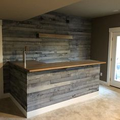 Franks design This bar and wood accent wall were built using our Nantucket Gray Wall Boards, by Seth Home Bar Rooms, Diy Home Bar, Bars For Home, Basement Bar Designs, Home Bar Designs, Rustic Basement Bar, Home Bar Plans, Custom Home Bars, Summer House Interiors