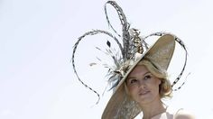 Amy Guy poses for photographers on the first day of Royal Ascot horse racing meet at Ascot, England, (Alistair Grant/AP)