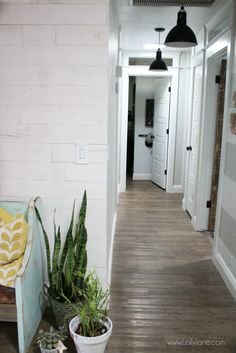 Such a pretty farmhouse hallyway with shiplap walls and pretty barn light pendants! Farmhouse Wall Decor, Farmhouse Lighting, Barn Lighting, Peel And Stick Shiplap, Stick On Wood Wall, Barn Light Electric, Home Goods Decor, Door Makeover, Ship Lap Walls