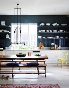 Black modern kitchen with white cabinets. The open shelving design is a nice touch.