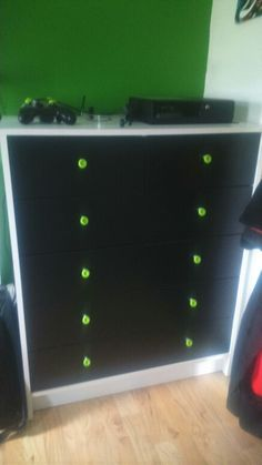 Black drawers with xbox control rubbers on as handles                                                                                                                                                      More