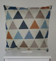 Multi-Coloured Triangle Scatter Cushion Cover - Beautifully simple multi-coloured triangle cushion cover. This cushion cover features a beautiful patchwork-style pattern in blue, navy, orange and cream. Bring colour and life to your bedroom or living room with this stylish scatter cushion.