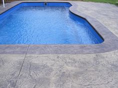 Stone coping with stamped concrete