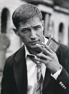 Tom Hardy-I still can't believe this is the guy who played Bane. He put on 30 lbs of muscle for the role.  Wow. Also this is a sexy picture of him.  ;)