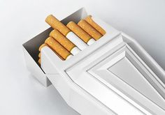 Enjoy Lung Cancer with Coffin Shaped Cigarette Packs - A design company from Ukraine with the same tone designed the following coffin shaped cigarette packs.