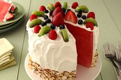 """Put your seasonal summer produce to delicious use with this sweet and refreshing Watermelon """"Cake"""" recipe. Made of sweet, refreshing watermelon and frosted with creamy COOL WHIP Whipped Topping, this fun fruit dessert is perfect for your next summer get-together! Bonus: this recipe can be made ahead of time for easy party prep!"""