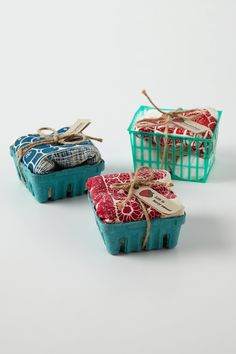 GIFT WRAP :: Cute idea on wrapping a tea towel or dish towel for a gift..strawberry baskets! Whether they be paper, ceramic (which could be a gift in itself) or plastic, they all look super cute w/ some twine & a homemade tag attached! | #giftwrap #teatowel #dishtowel #strawberrybasket #berrybasket