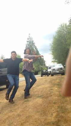 Jensen, trying to beat Jared to the birthday gifts brought to the set for him by fans :)
