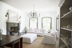Crisp white walls, antique chandelier, slip covered furniture, a mix of french country and shabby chic. Home Living Room, Apartment Living, Living Spaces, White Rooms, White Walls, White Sectional, Interior Decorating, Interior Design, Decorating Ideas
