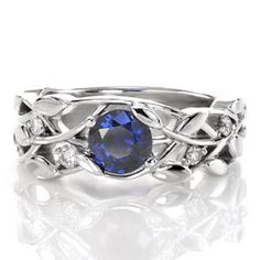 Delightful leaf and vine pattern with stunning round blue sapphire stone. #Knoxjewelers  #engagement #ring