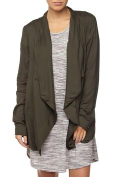 The Draped Front Anorak is a viscose cover-up featuring a draped front waterfall neck opening and long set-in sleeves. It is lightweight and perfect for all year round. Available in 3 colourways. Composition: 100% Viscose. Model wears: AUS 10/S.