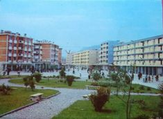 Pamje nga Shkodra, vuti 1986 Socialist State, Socialist Realism, Albania, Sidewalk, Street, Board, Sign, Walkway, Pavement