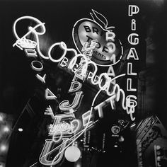 The neon of Paris by Night  by pioneering photojournalist Roger Schall, c1935,
