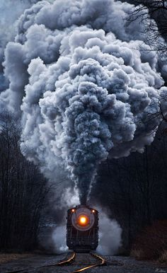 Powerful steel engines blowing huge, undulating clouds of smoke into the air emerge from the fog in these strikingly beautiful images by engineer and self-taught photographer Matthew Malkiewicz.