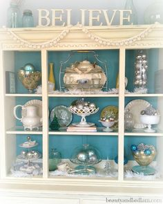 This gorgeous hutch ,decorated for the holidays, was an 80's brown, dated hutch.  With taking the glass doors off and adding a little chalk paint, it's an amazing transformation for only a few days. Must see the BEFORE/AFTER