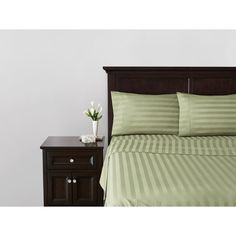 love the sage damask stripe sheets against dark headboard/accent table... would go beautifully with a purple or chocolate brown comforter