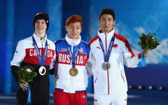 DAY 15:  (L-R) Bronze medalist Charle Cournoyer of Canada, celebrate, gold medalist Victor An of Russia and silver medalist Dajing Wu of China celebrate on the podium during the medal ceremony for the Short Track Men's 500m http://sports.yahoo.com/olympics