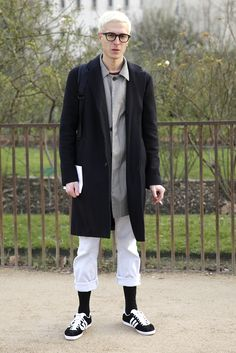 Monochrome winter tailoring with double-layered coats and a sporty streetwear edge at Paris Fashion Week.