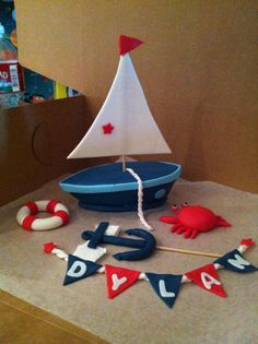 Fondant sail boat for nautical theme party. Easy to make. DIY