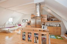 Apartments:Brown Cupboard With A Wooden And Glass Material Complete With A Stainless Steel Table Kitchen And Modern Refrigerator Also Modern...