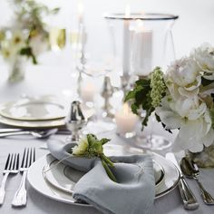 Table all a'glow. Shop this silver + white look plus get tips for setting the perfect table via our profile link. #WeddingWednesday